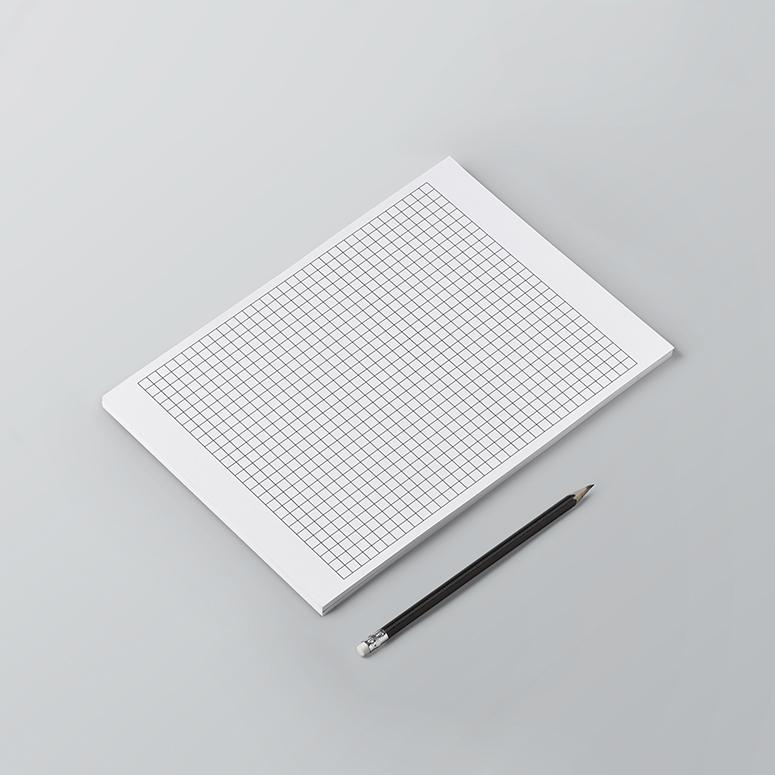 Σελίδες μπλοκ σημειώσεων με πλέγμα καρέ (τετραγώνα), κατάλληλες για σχεδιασμό.